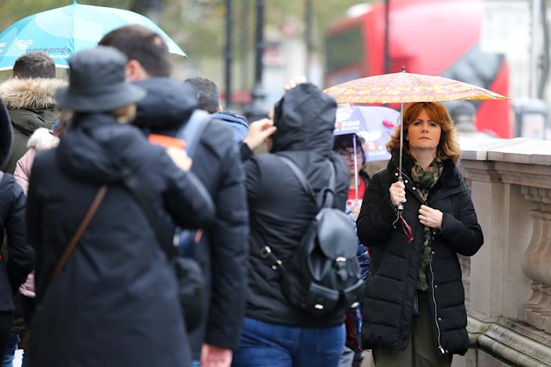 LONDON, UNITED KINGDOM - 2019/11/01: A woman shelters from the rain underneath an umbrella on a wet day. 70mm rain expected as UK braces for heavy showers and gale force winds this weekend. (Photo by Steve Taylor/SOPA Images/LightRocket via Getty Images)