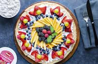 """<p>Cookie dough and fresh fruit are running mates in this (pizza) party. For the health nuts out there, this dessert gets topped with all sorts of berries, a <a href=""""https://www.thedailymeal.com/healthy-eating/eat-these-foods-every-day?referrer=yahoo&category=beauty_food&include_utm=1&utm_medium=referral&utm_source=yahoo&utm_campaign=feed"""" rel=""""nofollow noopener"""" target=""""_blank"""" data-ylk=""""slk:food everyone should be eating every day."""" class=""""link rapid-noclick-resp"""">food everyone should be eating every day.</a></p> <p><a href=""""https://www.thedailymeal.com/recipes/fruit-pizza-recipe?referrer=yahoo&category=beauty_food&include_utm=1&utm_medium=referral&utm_source=yahoo&utm_campaign=feed"""" rel=""""nofollow noopener"""" target=""""_blank"""" data-ylk=""""slk:For the Fruit Pizza recipe, click here."""" class=""""link rapid-noclick-resp"""">For the Fruit Pizza recipe, click here.</a></p>"""