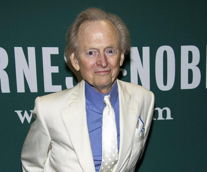 """FILE - This Oct. 23, 2012 file photo shows author Tom Wolfe at a book signing for his novel """"Back to Blood"""" at Barnes & Noble in New York. Wolfe's """"Back to Blood"""" came out this fall and he has more fiction and nonfiction planned. """"Being an octogenarian is just a hobby of mine,"""" Wolfe, 81, says with a laugh, """"something I do at night."""" (Photo by Charles Sykes/Invision/AP, file)"""