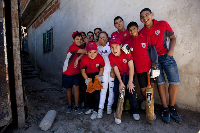 Caacupe cricket team players pose for a picture at the Villa 21-24 slum in Buenos Aires, Argentina, Saturday, March 22, 2014. The International Cricket Council has recognized the team, formed from the children of the Villa 21-24 shantytown, honoring them as a global example for expanding the sport, which in certain countries, like India, is widely played, but in many parts of the world restricted to elite sectors of society. Introducing cricket in the slum began in 2009 as an idea to transform the game into a social integration mechanism, before that it rarely breached the gates of the country's upscale private schools. (AP Photo/Natacha Pisarenko)