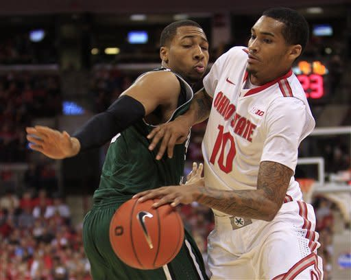 Ohio State's LaQuinton Ross, right, tries to dribble past Chicago State's Aaron Williams during the second half of an NCAA college basketball game on Saturday, Dec. 29, 2012, in Columbus, Ohio. Ohio State defeated Chicago State 87-44. (AP Photo/Jay LaPrete)