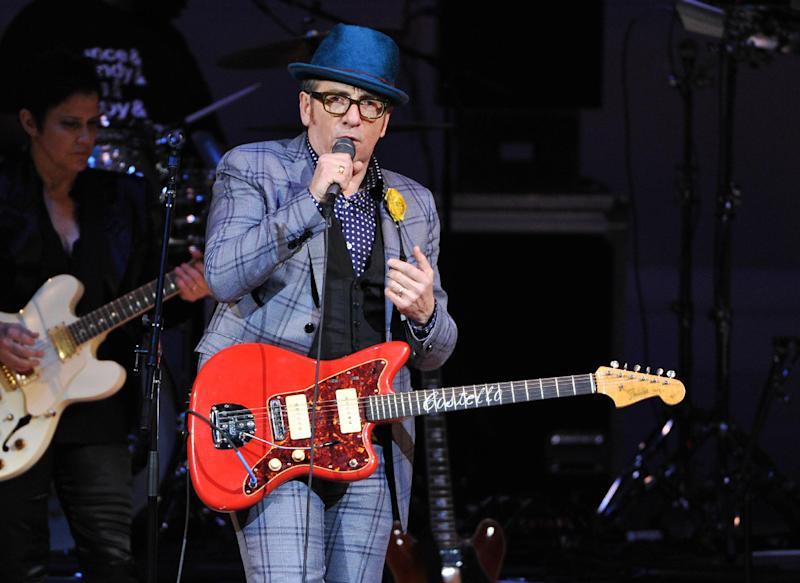 "FILE - In this March 7, 2013 file photo, musician Elvis Costello performs at ""The Music of Prince"" tribute concert at Carnegie Hall, in New York. One of television's most successful sitcom writers is joining with Burt Bacharach and Elvis Costello to create a musical based on the artists' 1998 album ""Painted From Memory."" Bacharach said Tuesday, May 7, 2013, that Chuck Lorre, creator of ""Two and a Half Men"" and ""The Big Bang Theory,"" contacted him and said he wanted to write a  story to go with the music. (Photo by Evan Agostini/Invision/AP, File)"
