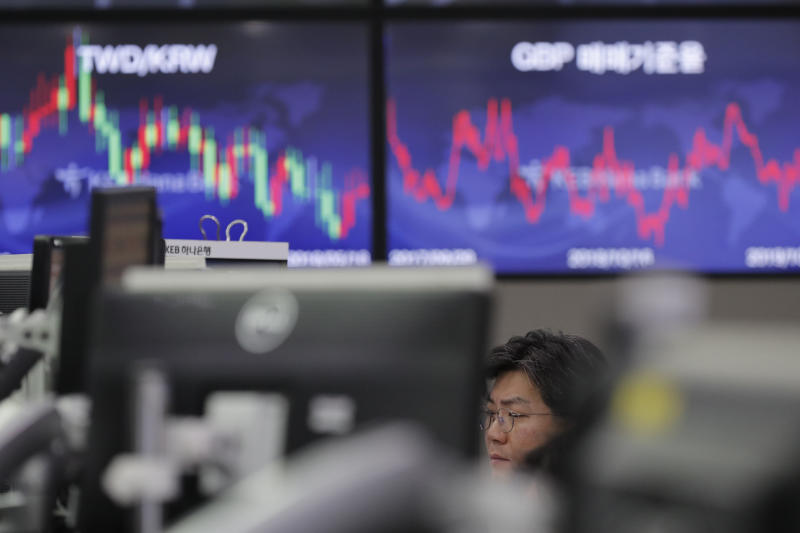 A currency trader watches computer monitors at the foreign exchange dealing room in Seoul, South Korea, Friday, Oct. 18, 2019. Share prices retreated in Asia after China reported Friday that its economy grew at an annual rate of 6.0% in the latest quarter. (AP Photo/Lee Jin-man)