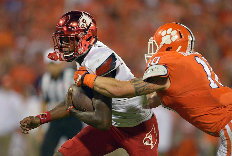 CLEMSON, SC - OCTOBER 01: Lamar Jackson #8 of the Louisville Cardinals is sacked by Ben Boulware #10 of the Clemson Tigers during the second quarter at Memorial Stadium on October 1, 2016 in Clemson, South Carolina. (Photo by Grant Halverson/Getty Images)