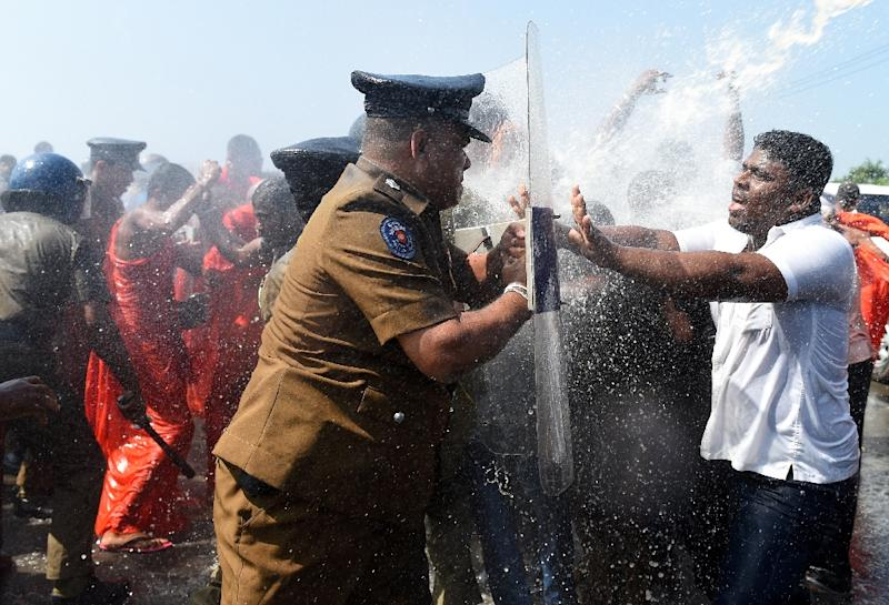Sri Lankan police use water canons to disperse activists and Buddhist monks during a protest in the southern port city of Hambantota on January 7, 2017