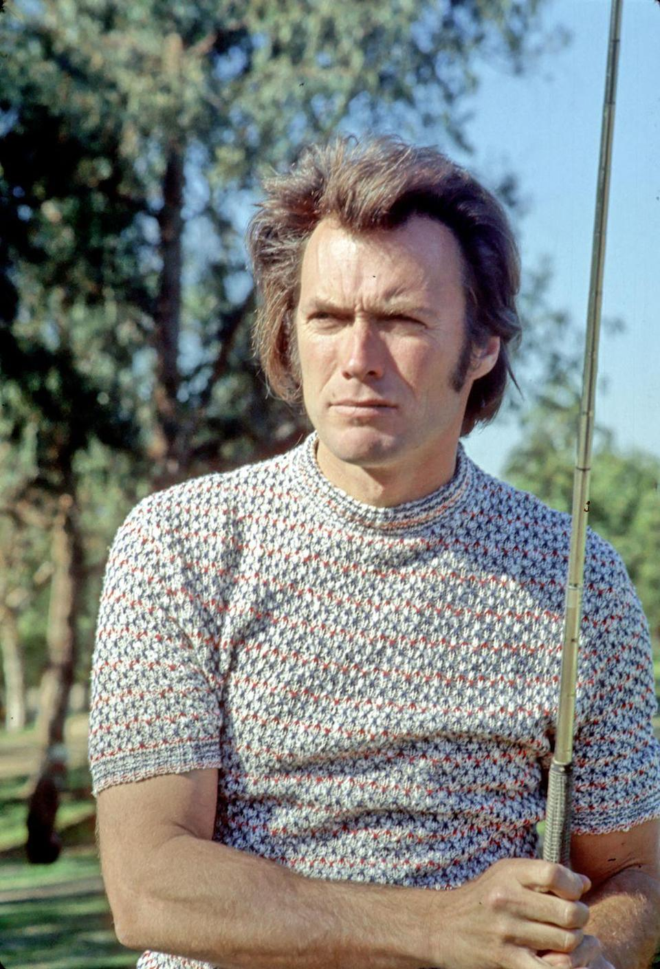 <p>Clint Eastwood stares down a shot in 1975. </p>