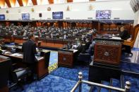 Malaysia's members of parliament attend a session of the lower house of parliament, in Kuala Lumpur