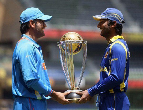 MS Dhoni & Kumar Sangakkara with the World Cup trophy ahead of the 2011 final