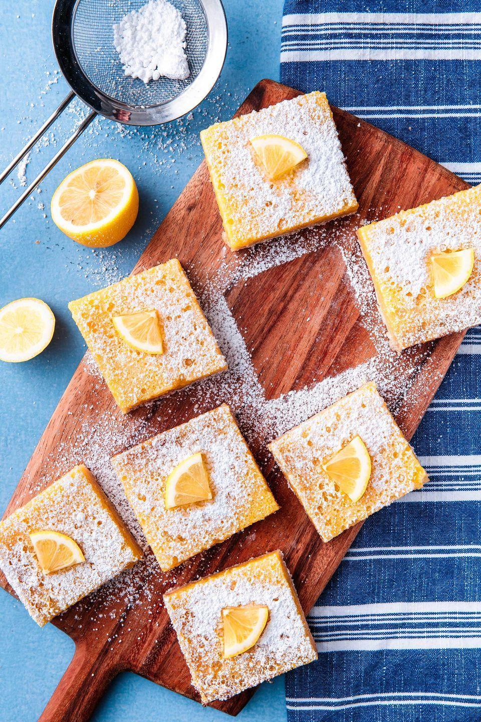 """<p>Pucker up — these babies are sweet and citrusy.</p><p>Get the recipe from <a href=""""https://www.delish.com/cooking/recipes/a52125/easy-lemon-bars-recipe/"""" rel=""""nofollow noopener"""" target=""""_blank"""" data-ylk=""""slk:Delish"""" class=""""link rapid-noclick-resp"""">Delish</a>. </p>"""