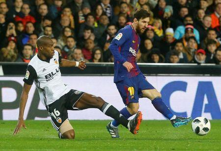 Soccer Football - Spanish King's Cup Semi Final Second Leg - Valencia vs FC Barcelona - Mestalla, Valencia, Spain - February 8, 2018 Barcelona's Lionel Messi in action with Valencia's Geoffrey Kondogbia REUTERS/Heino Kalis