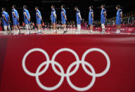Italy players line up on the court for national anthem prior to men's basketball preliminary round game between Germany and Italy at the 2020 Summer Olympics, Sunday, July 25, 2021, in Saitama, Japan. (AP Photo/Charlie Neibergall)
