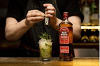 """<p>1 1/2 oz RedBush</p><p>1/2 oz Creme De Cacao</p><p>1/2 oz Simple Syrup</p><p>3/4 oz Lemon Juice </p><p>2 Dash Angostura </p><p>Fresh Mint</p><p>Build and churn over crushed ice, serve with mint sprig and nutmeg. Combine all in highball glass, top with soda, and garnish with a grapefruit slice.</p><p><em>Via <a href=""""https://www.underdogbarnyc.com/story"""" rel=""""nofollow noopener"""" target=""""_blank"""" data-ylk=""""slk:Conor Myers of Underdog NYC"""" class=""""link rapid-noclick-resp"""">Conor Myers of Underdog NYC</a></em> </p>"""