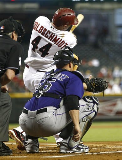 Arizona Diamondbacks' Paul Goldschmidt (44) connects for a solo home run as Colorado Rockies catcher Ramon Hernandez watches during the second inning of a baseball game, Monday, July 23, 2012, in Phoenix. (AP Photo/Matt York)