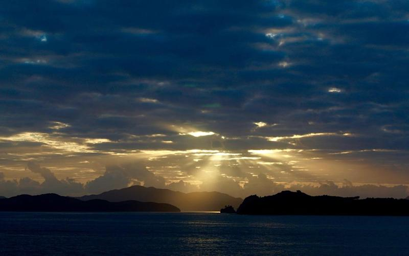 Morning breaks over New Zealand's Bay of Islands. | Jillian Dara