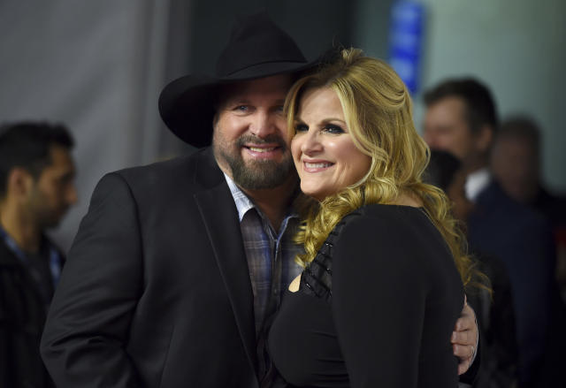 CORRECTS YEAR TO 2019 - Garth Brooks, left, and Trisha Yearwood arrive at MusiCares Person of the Year honoring Dolly Parton on Friday, Feb. 8, 2019, at the Los Angeles Convention Center. (Photo by Jordan Strauss/Invision/AP)