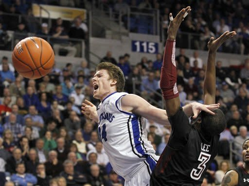 Saint Louis' Brian Conklin, left, is fouled on his way to the basket by Temple's Anthony Lee during the second half of an NCAA college basketball game Wednesday, Jan. 11, 2012, in St. Louis. Temple won 72-67. (AP Photo/Jeff Roberson)