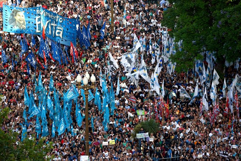 Crowds responding to an online call by organizers swamped the Plaza de Mayo square to protest against President Mauricio Macri's bid to repeal a law by his leftist predecessor that outlawed monopolies by media companies
