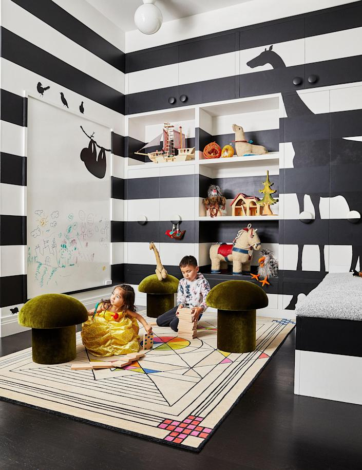 <p>In the Playroom, mushroom stools by Maison Gerard stand on a Renate Müller rug. The walls were custom painted.</p> <p>(© 2021 Estate of Louise Nevelson / Artists Rights Society (ARS), New York.)</p>