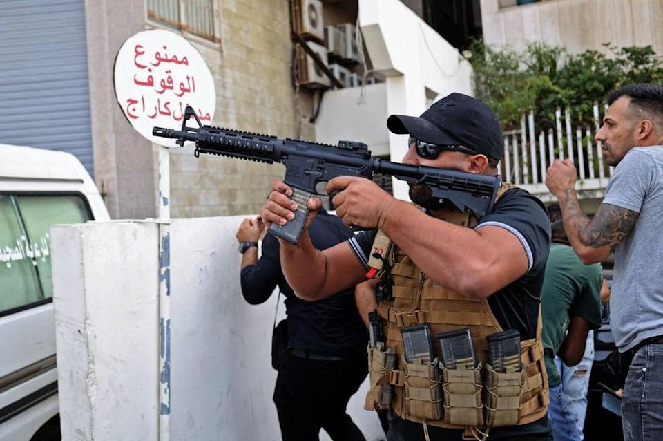 A fighter from the Amal movement takes aim during the clashes (AFP via Getty Images)