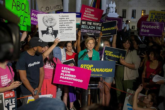 <p>Senator Elizabeth Warren (D-MA) speaks to protesters in front of the U.S. Supreme Court on July 9, 2018 in Washington, D.C. (Photo: Tasos Katopodis/Getty Images) </p>