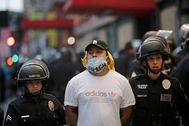 PHOTO: A demonstrator is taken into custody after the city's curfew went into effect in Los Angeles, June 2, 2020. (Jae C. Hong/AP)