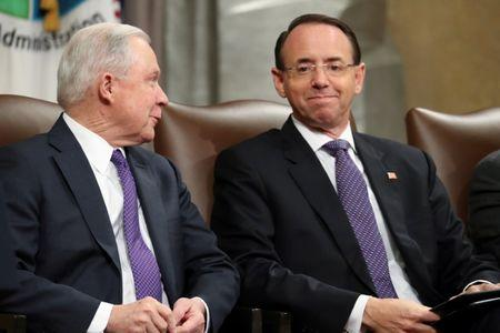 FILE PHOTO: U.S. Attorney General Jeff Sessions and Deputy Attorney General Rod Rosenstein participate in a National Opioid Summit at the Justice Department in Washington, U.S. October 25, 2018. REUTERS/Jonathan Ernst/File Photo