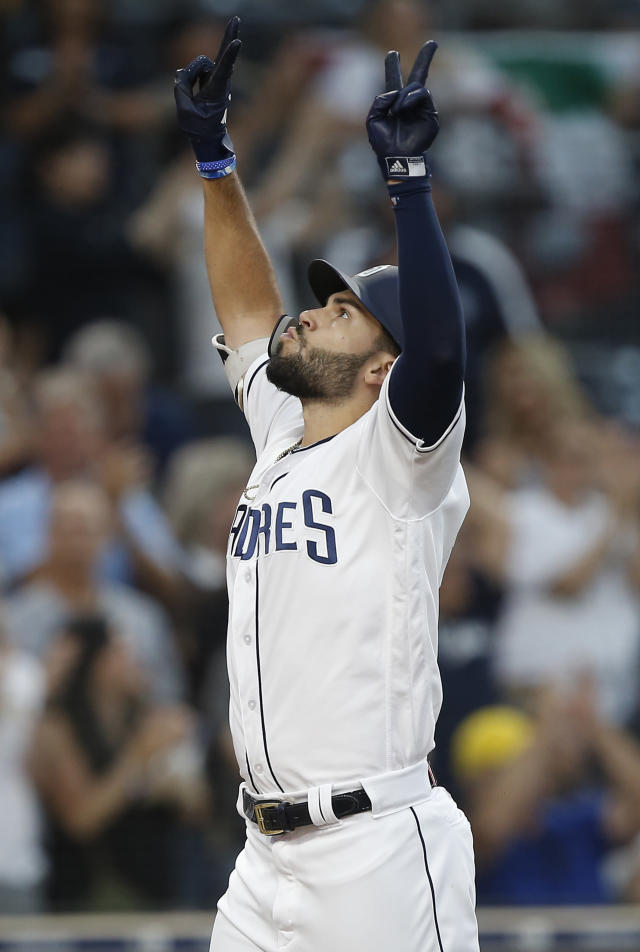 San Diego Padres' Eric Hosmer reacts as he returns to the plate after hitting a three-run home run against the Texas Rangers during the third inning of a baseball game in San Diego, Saturday, Sept. 15, 2018. (AP Photo/Alex Gallardo)