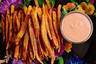 """<p>These salty, buttery, oven-baked fries are one of Ree's all-time favorite snacks. Pair them with a simple spicy mayo: Just mix three parts mayonnaise with one part Sriracha. </p><p><strong><a href=""""https://www.thepioneerwoman.com/food-cooking/recipes/a11855/sweet-potato-fries/"""" rel=""""nofollow noopener"""" target=""""_blank"""" data-ylk=""""slk:Get Ree's recipe."""" class=""""link rapid-noclick-resp"""">Get Ree's recipe.</a></strong></p><p><a class=""""link rapid-noclick-resp"""" href=""""https://www.amazon.com/s?k=sriracha&ref=nb_sb_noss&tag=syn-yahoo-20&ascsubtag=%5Bartid%7C2164.g.36876289%5Bsrc%7Cyahoo-us"""" rel=""""nofollow noopener"""" target=""""_blank"""" data-ylk=""""slk:SHOP SRIRACHA"""">SHOP SRIRACHA </a></p>"""