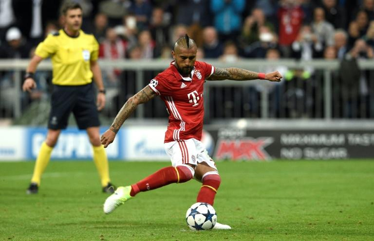 Bayern Munich's midfielder Arturo Vidal kicks a penalty during the UEFA Champions League 1st leg quarter-final football match against Real Madrid in Munich, southen Germany on April 12, 2017