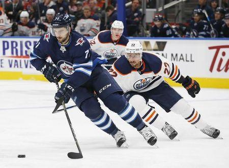 Sep 23, 2017; Edmonton, Alberta, CAN; Edmonton Oilers forward Chris Kelly (22) chases Winnipeg Jets defensemen Julian Melchioro (71) during the third period at Rogers Place. Mandatory Credit: Perry Nelson-USA TODAY Sports
