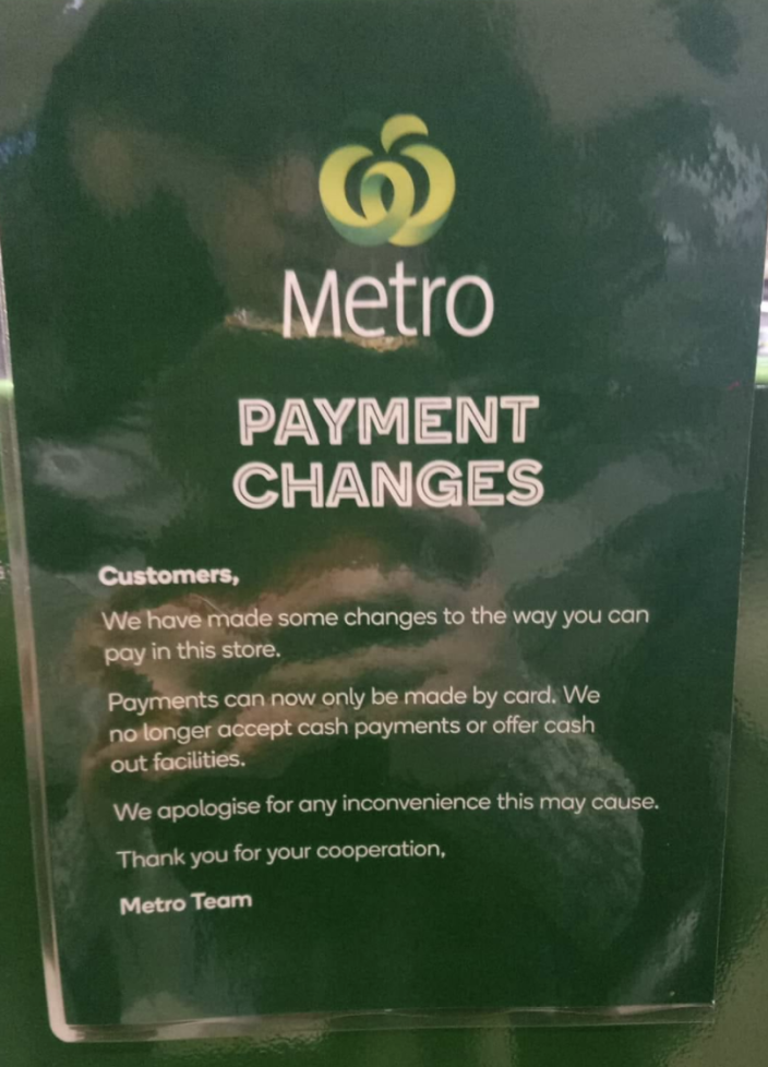 This sign was displayed at one of the Woolworth Metro stores no longer accepting cash. Source: Facebook