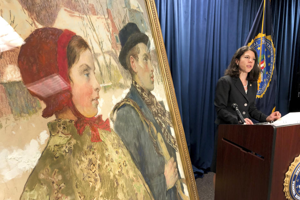 """Acting U.S Attorney for the Northern District of New York, Antoinette T. Bacon, speaks at a repatriation ceremony for the painting """"Winter"""" Thursday, Oct. 15, 2020, in Albany, N.Y. The painting, discovered in an upstate New York museum, was part of a cache of art seized by the Nazis from the Mosse family in Berlin in 1933. (AP Photo/Michael Hill)"""