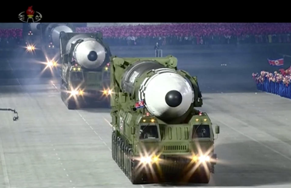 "This image made from video broadcasted by North Korea's KRT, shows a military parade with what appears to be a possible new solid-fuel missile at the Kim Il Sung Square in Pyongyang, Saturday, Oct. 10, 2020. North Korean leader Kim Jong Un warned Saturday that his country would ""fully mobilize"" its nuclear force if threatened as he took center stage at a massive military parade to mark the 75th anniversary of the country's ruling party. (KRT via AP)"