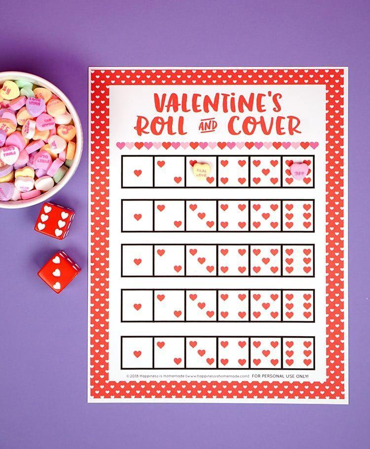"""<p>This game offers a little something extra to do with your candy before you all gobble it down. Print this card, roll the die (or dice), cover up the number you get with a conversation heart or Hershey Kiss and whoever covers their whole board first wins!</p><p><em><a href=""""https://www.happinessishomemade.net/valentine-games-roll-cover/"""" rel=""""nofollow noopener"""" target=""""_blank"""" data-ylk=""""slk:Get the tutorial at Happiness Is Homemade »"""" class=""""link rapid-noclick-resp"""">Get the tutorial at Happiness Is Homemade »</a></em></p>"""
