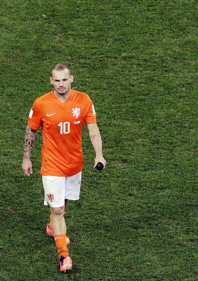 Netherlands' Wesley Sneijder leaves the pitch at the end of the World Cup semifinal soccer match between the Netherlands and Argentina at the Itaquerao Stadium in Sao Paulo Brazil, Wednesday, July 9, 2014. Argentina reached the World Cup final on Wednesday after beating the Netherlands 4-2 in a penalty shootout.(AP Photo/Hassan Ammar)