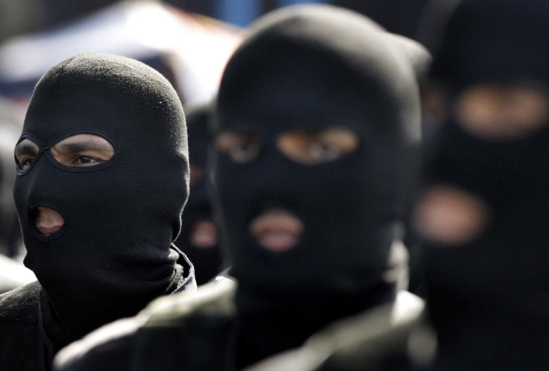 Masked Iranian army troops march in a military parade commemorating the start of the Iraq-Iran war 32 years ago, in front of the mausoleum of the late revolutionary founder Ayatollah Khomeini, outside Tehran, Iran, Friday, Sept. 21, 2012. (AP Photo/Vahid Salemi)
