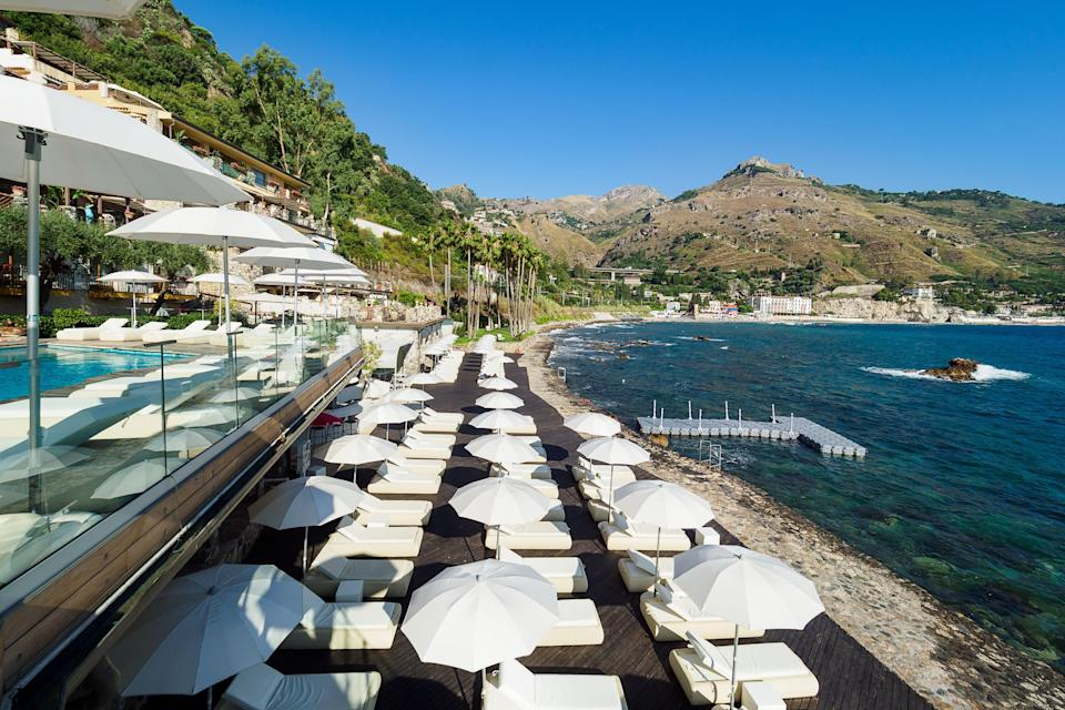 Overlooking the Baia delle Sirene from the terraces of Atlantis Bay Hotel.