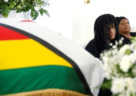 Mugabe's family says burial to be private, in snub to successor