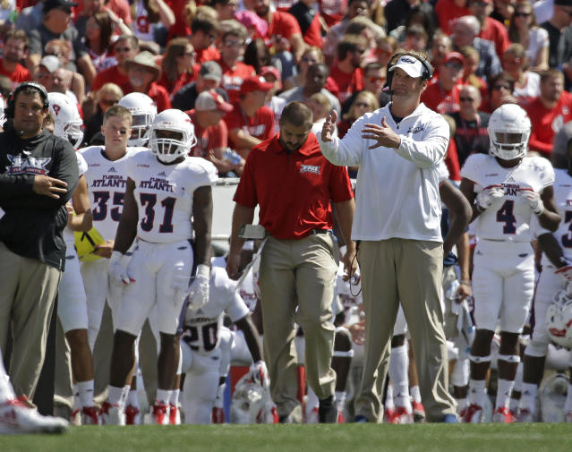 Florida Atlantic head coach Lane Kiffin looks up from the sidelines during an NCAA college football game against Wisconsin Saturday, Sept. 9, 2017 in Madison, Wis. (AP Photo/Aaron Gash)