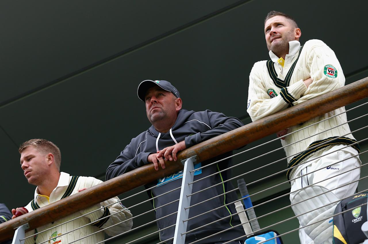 WORCESTER, ENGLAND - JULY 02: David Warner of Australia, Darren Lehmann, coach of Australia, and Michael Clarke of Australia look on during day one of the Tour Match between Worcestershire and Australia at New Road on July 2, 2013 in Worcester, England.  (Photo by Ryan Pierse/Getty Images)