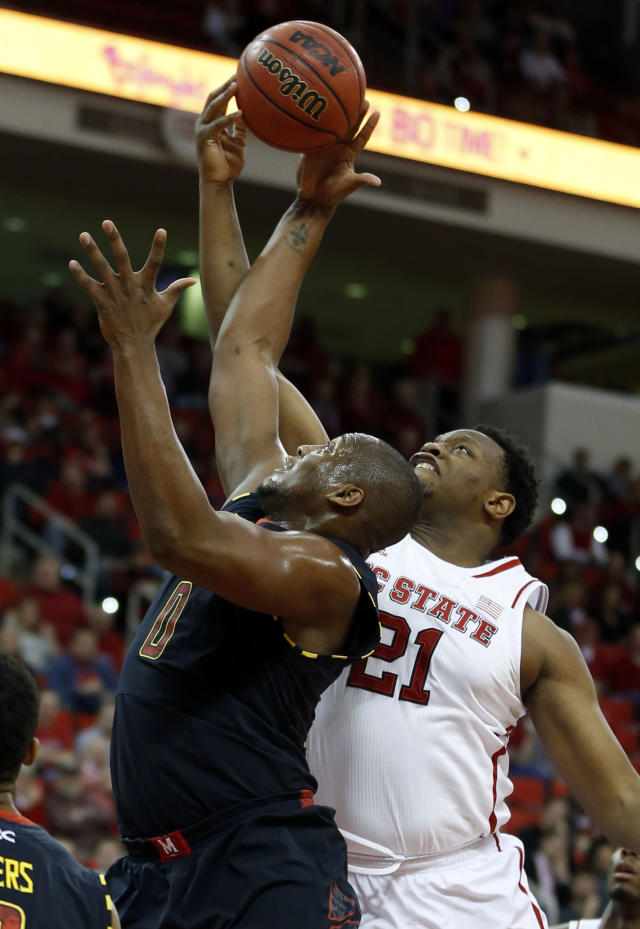 N.C. State's Beejay Anya (21), right, fights for a rebound with Maryland's Charles Mitchell (0) during the first half of N.C. State's game against Maryland at PNC Arena in Raleigh, N.C. Monday, Jan. 20, 2014. (AP Photo/The News & Observer, Ethan Hyman)