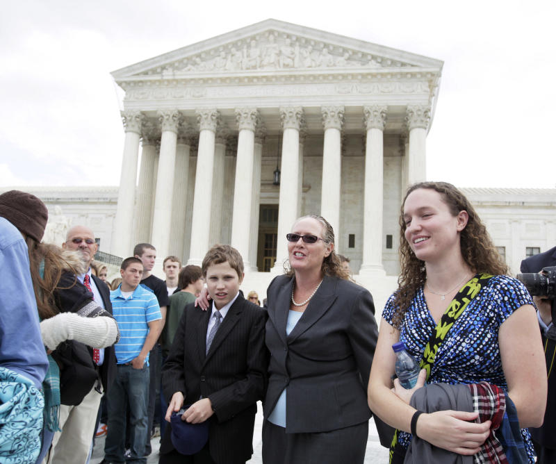FILE - In this Oct. 6, 2010 file photo, Margie Phelps, second from right, a daughter of Fred Phelps, and the lawyer who argued the case for of the Westboro Baptist Church, of Tokepa Kan., walks from the Supreme Court, in Washington.  The Supreme Court has ruled that the First Amendment protects fundamentalist church members who mount attention-getting, anti-gay protests outside military funerals. (AP Photo/Carolyn Kaster, File)