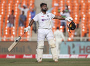 India's Rishabh Pant celebrates scoring a century during the second day of fourth cricket test match between India and England at Narendra Modi Stadium in Ahmedabad, India, Friday, March 5, 2021. (AP Photo/Aijaz Rahi)