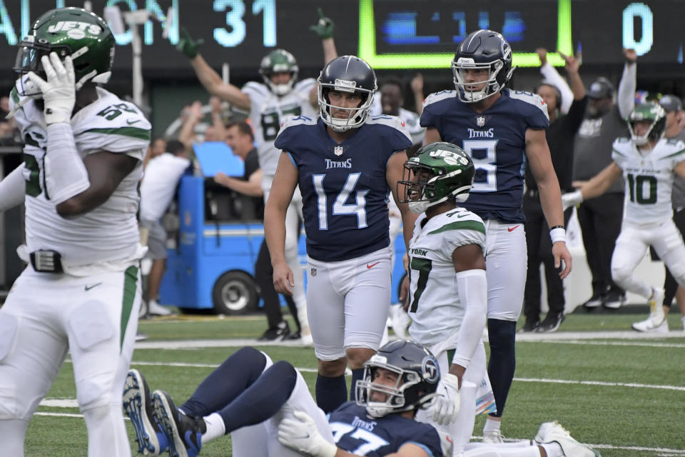 Tennessee Titans kicker Randy Bullock (14) reacts after missing a field goal and giving the win to the New York Jets during overtime of an NFL football game, Sunday, Oct. 3, 2021, in East Rutherford, N.J. (AP Photo/Bill Kostroun)