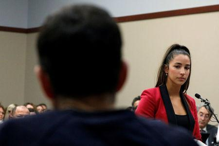 Victim and Olympic gold medalist Aly Raisman speaks at the sentencing hearing for Larry Nassar, (R) a former team USA Gymnastics doctor who pleaded guilty in November 2017 to sexual assault charges, in Lansing