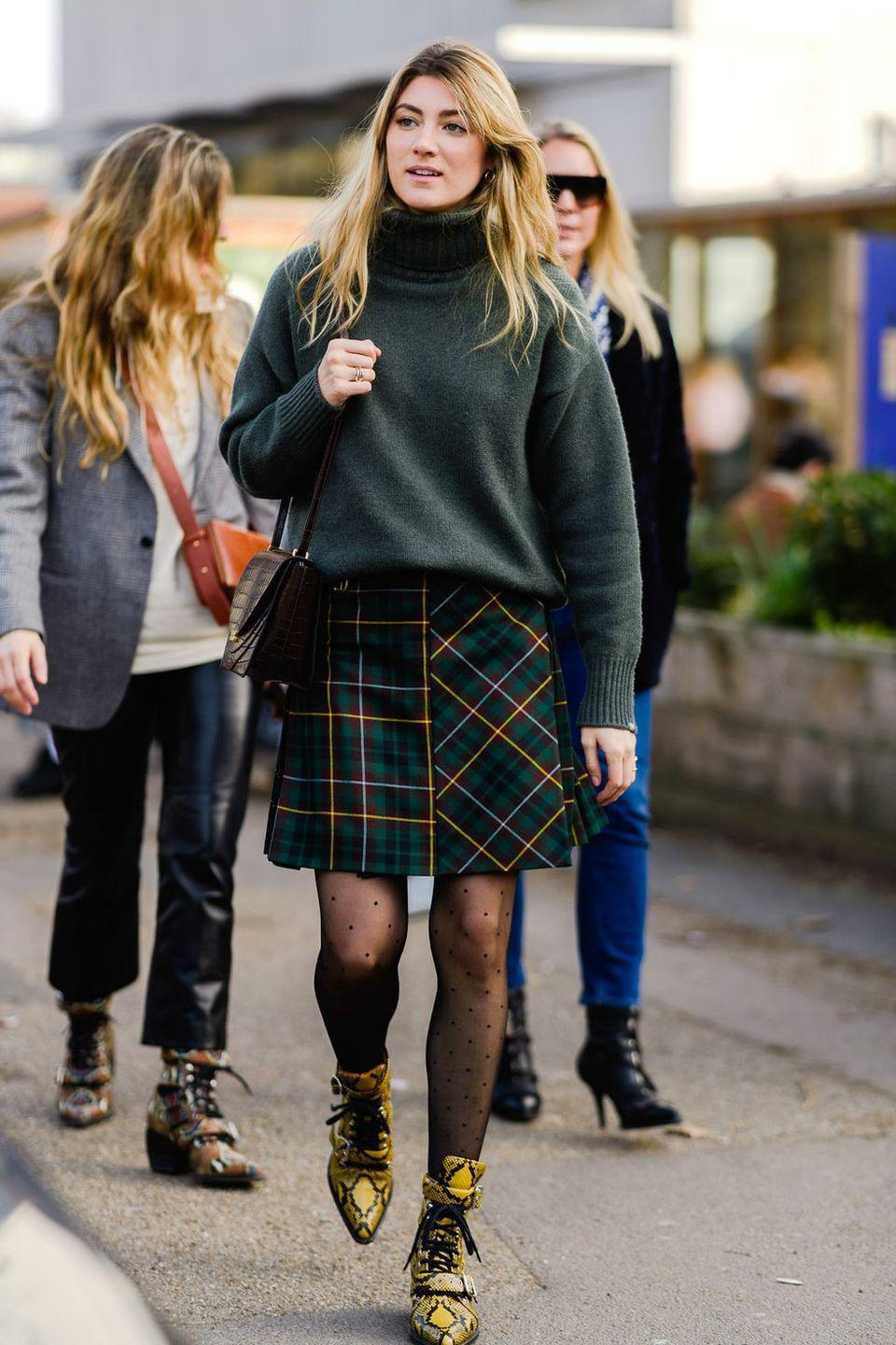 <p>Transition your miniskirt to fall by wearing it with a pair of textured tights and boots. </p>