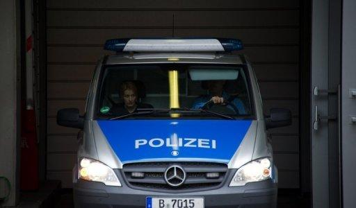 A police car transports Luka Rocco Magnotta (unseen) from the main detention center in Berlin