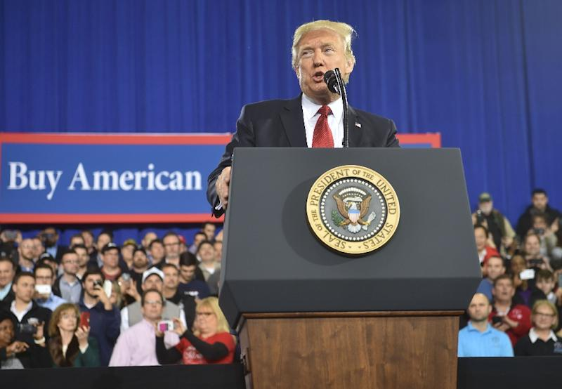 """US President Donald Trump tells automotive workers: """"We're going to help the companies, and they're going to help you"""""""