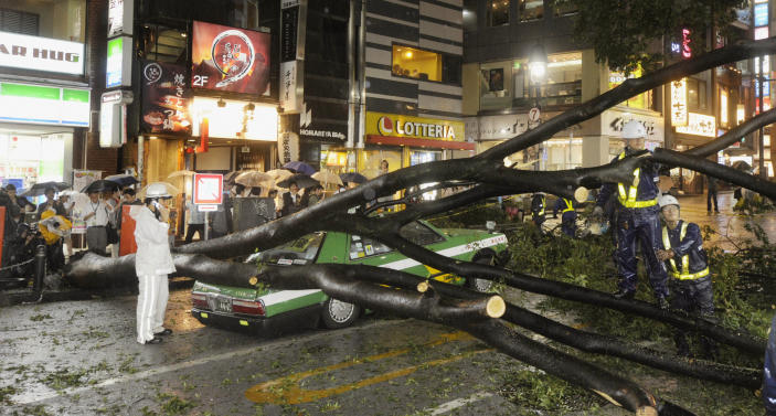A taxi is partially crushed by a fallen tree due to strong wind caused by Typhoon Roke in Shibuya district in Tokyo in this photo by Kyodo September 21, 2011. A powerful typhoon struck Japan on Wednesday, pummelling the Tokyo area with heavy rain, disrupting public transportation and leaving four people dead, and it was headed towards the tsunami-crippled Fukushima nuclear plant. (Photo: REUTERS/Kyodo)