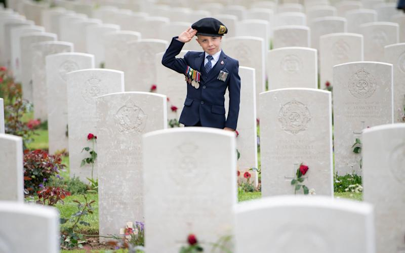 Six-year-old George Sayer paying tribute to his great uncle, who landed on Sword Beach on D-Day - Paul Grover FOR THE TELEGRAPH